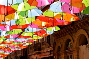 Agueda, Portugal - umbrella installation over a street - Portugal car hire
